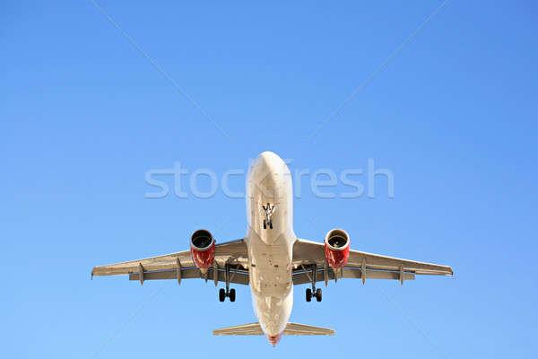 airplane overhead against blue sky Stock photo © alptraum