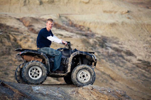 teen on quad ATV in the hills Stock photo © alptraum