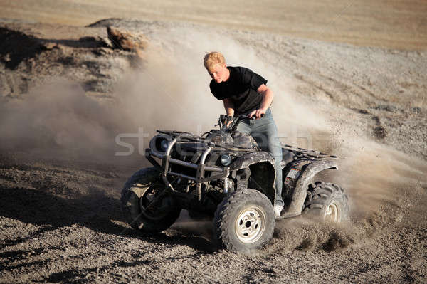 teenager riding quad - four wheeler Stock photo © alptraum