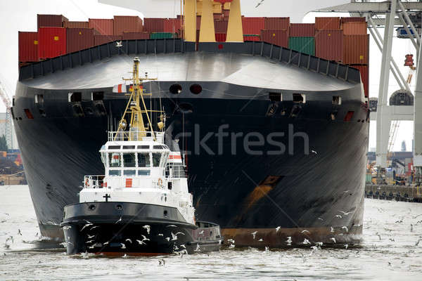 tugboat towing freighter in harbor Stock photo © alptraum