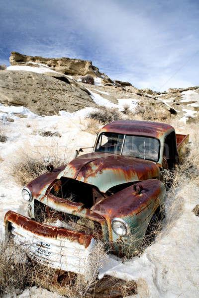 Opuszczony samochodu śniegu z dala niebo Zdjęcia stock © alptraum