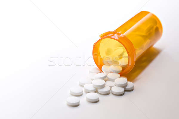 aspirin medicine with bottle on white Stock photo © alptraum