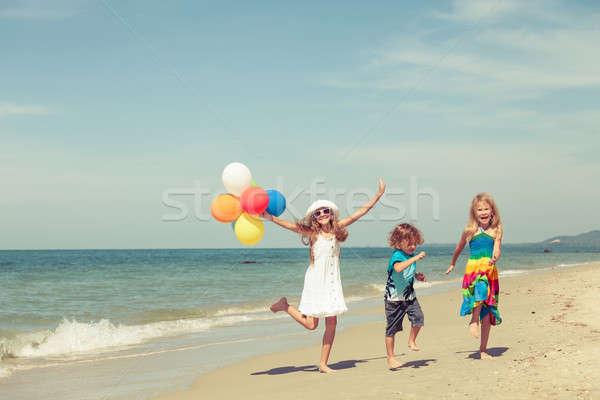 три счастливым детей танцы пляж день Сток-фото © altanaka