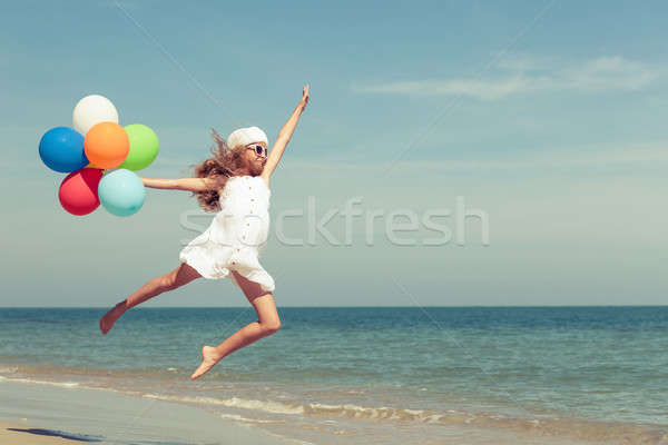 Сток-фото: подростка · девушка · прыжки · пляж · шаров · день · время
