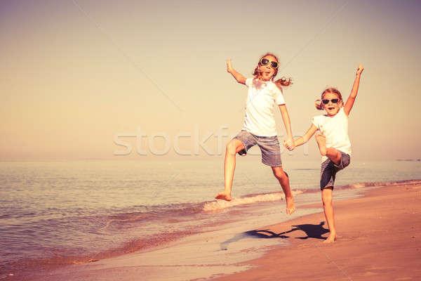 два играет пляж день время Сток-фото © altanaka
