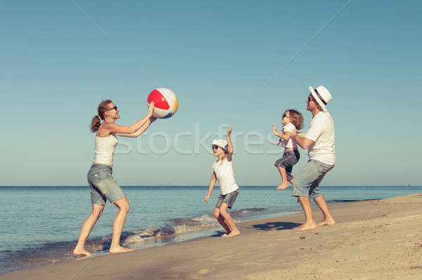 счастливая семья играет пляж день время дружественный Сток-фото © altanaka