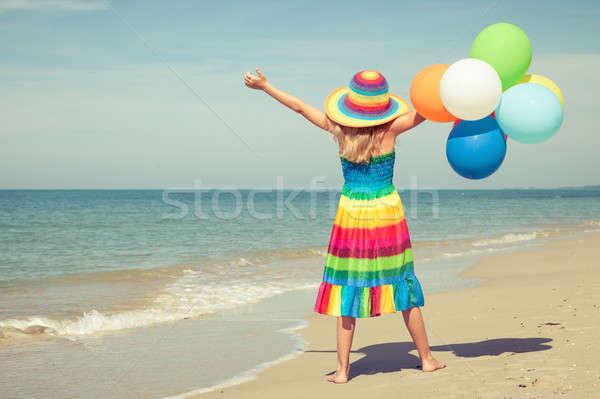 女の子 風船 立って ビーチ 日 時間 ストックフォト © altanaka