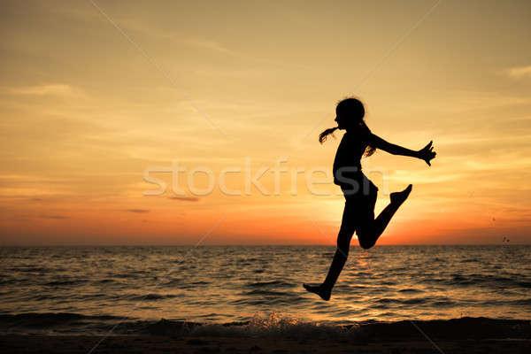 幸せ 十代の少女 ジャンプ ビーチ 日没 時間 ストックフォト © altanaka