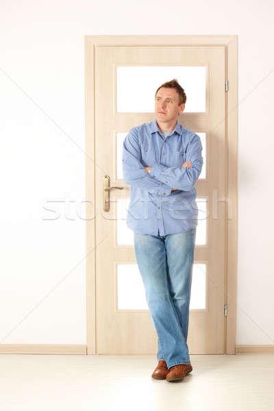 привлекательный человека Постоянный двери дизайнера Сток-фото © Amaviael