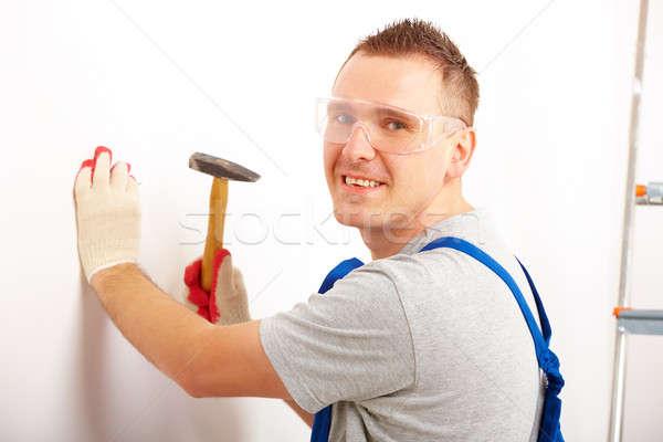 Man working with hammer Stock photo © Amaviael