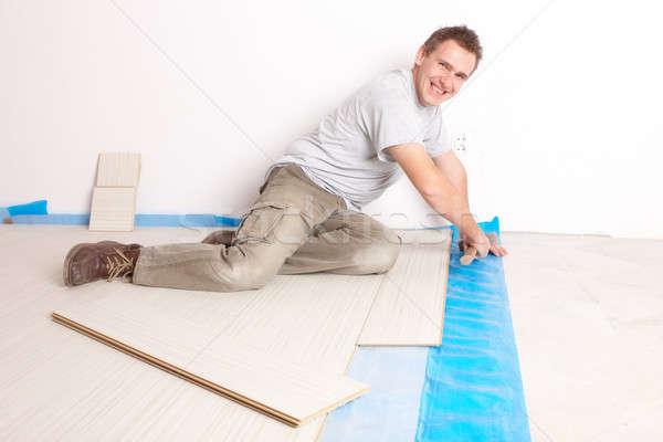 Worker installing a laminated flooring Stock photo © Amaviael