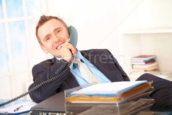 счастливым бизнесмен телефон сидят служба говорить Сток-фото © Amaviael