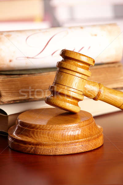 Stock photo: Judges gavel with very old books
