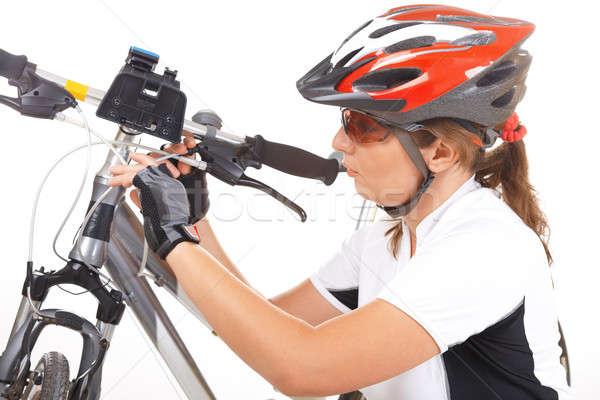 Girl Cyclist repair her bike Stock photo © Amaviael