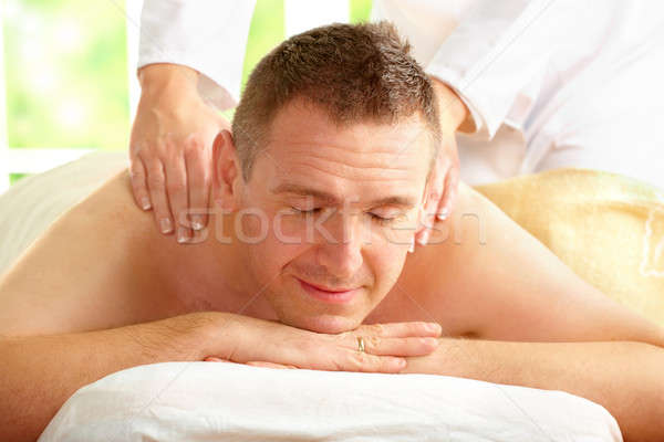Male enjoying massage treatment Stock photo © Amaviael