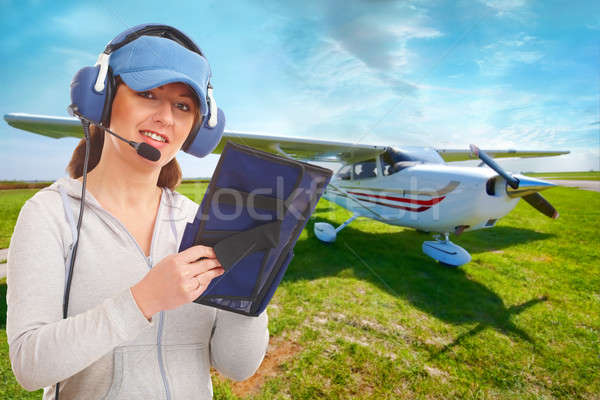 Stock photo: Pilot with headset and knee-pad