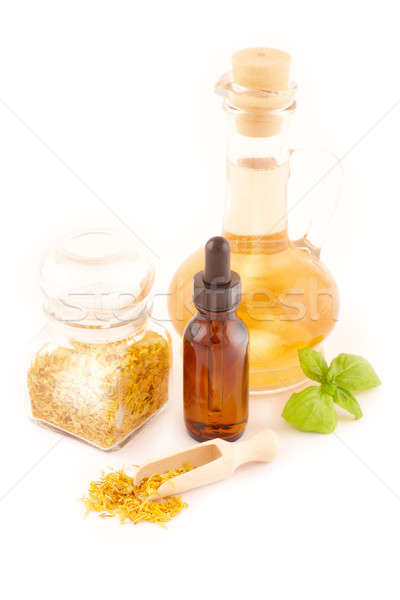 Dried caledula officinalis petals with macerated oil Stock photo © Amaviael