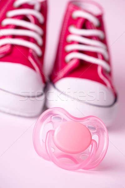 Dummy and baby shoes Stock photo © Amaviael
