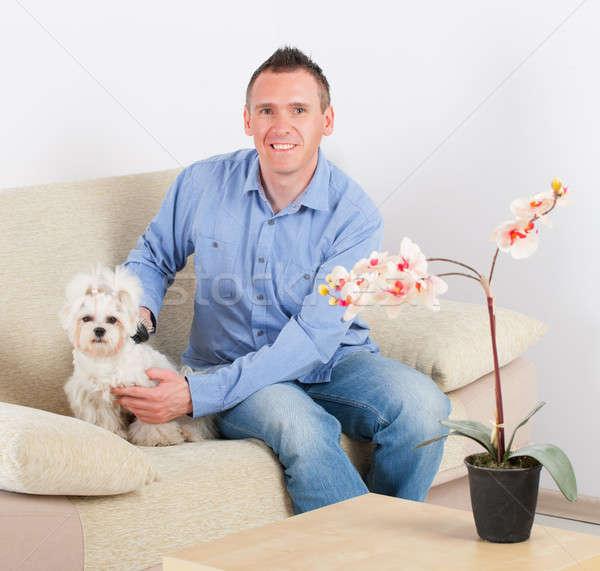 Kutya tulajdonos kanapé otthon boldog férfiak Stock fotó © Amaviael