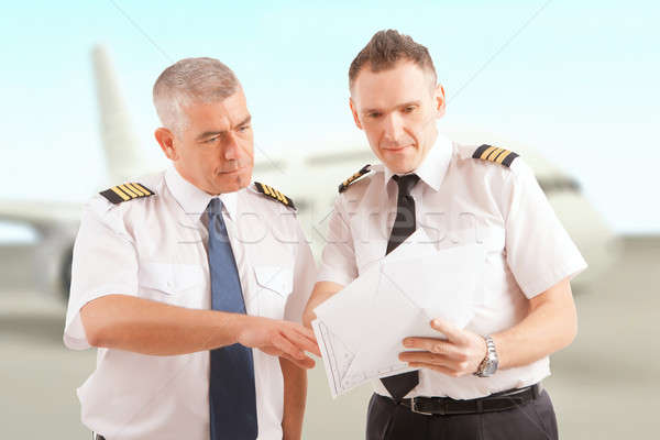 Airline pilots at the airport Stock photo © Amaviael