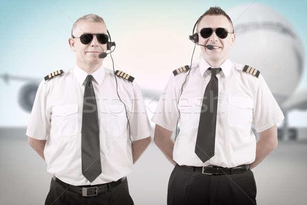 Légitársaság derűs visel egyenruhák áll mosoly Stock fotó © Amaviael