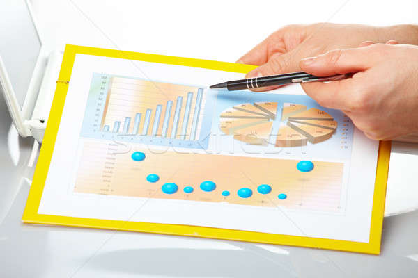 Business graphs and male hands Stock photo © Amaviael
