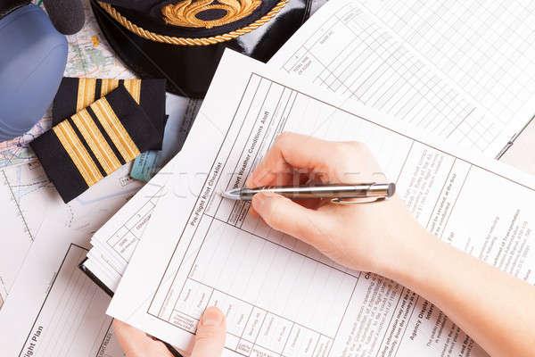 Airplane pilot filling in flight plan Stock photo © Amaviael