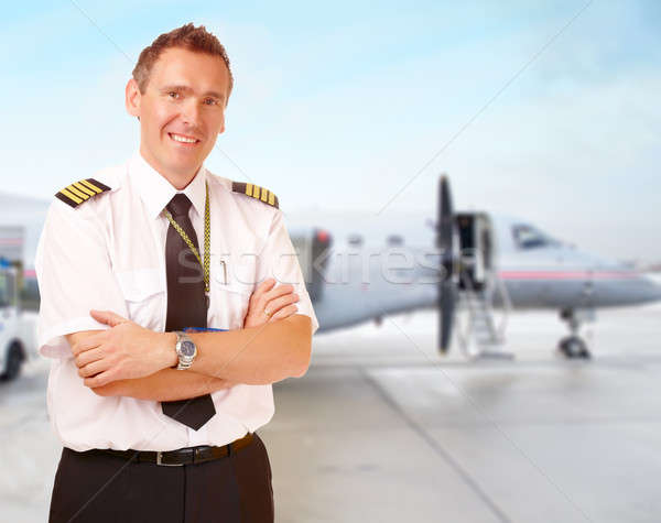 Airline pilot at the airport Stock photo © Amaviael