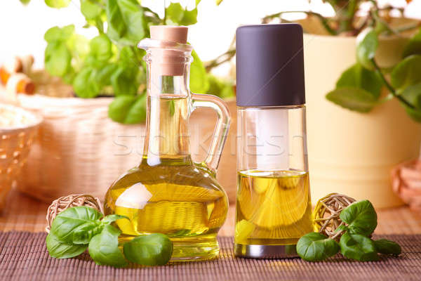 Two bottles with olive oil and grape seed oil Stock photo © Amaviael