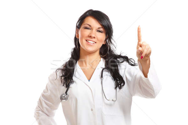 Medicine woman doctor pointing at something with her finger Stock photo © Amaviael