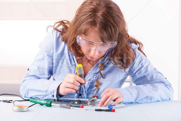 женщину компьютер красивая женщина очки Сток-фото © Amaviael
