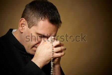 Imádkozik pap rózsafüzér kezek Biblia fiatal Stock fotó © Amaviael