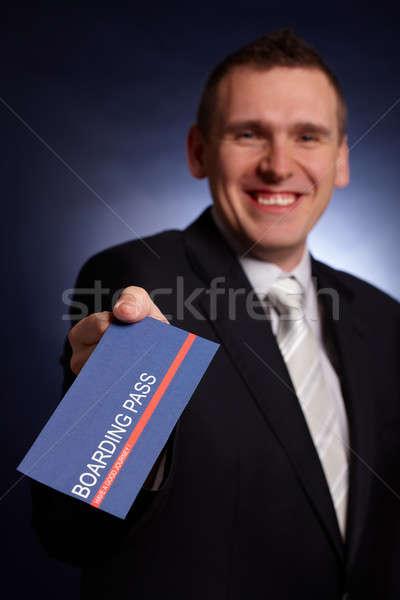 Business man holding a boarding pass  Stock photo © Amaviael