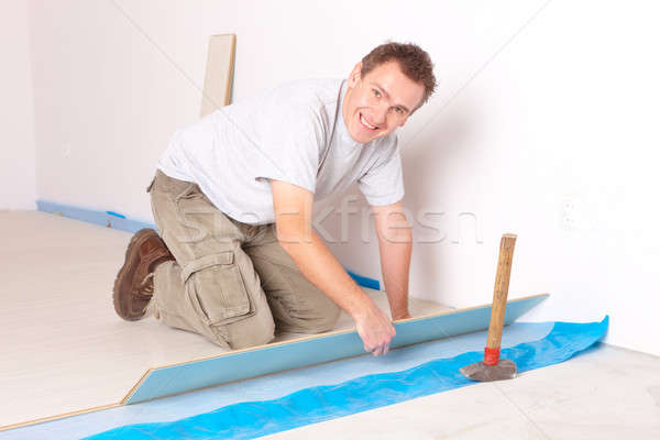 Worker installing a laminated flooring Stock photo © Amaviael