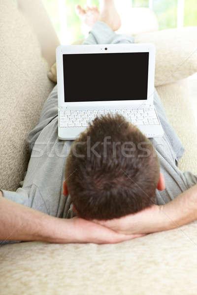 человека используя ноутбук домой диван компьютер Сток-фото © Amaviael
