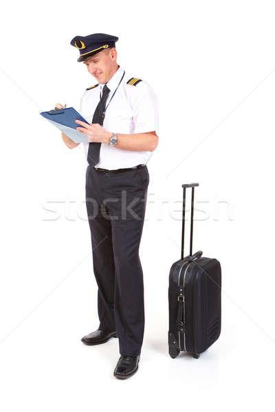 Légitársaság pilóta tömés papírok visel kalap Stock fotó © Amaviael