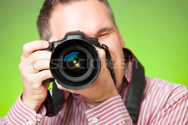 Fotógrafo cámara masculina toma fotos dslr Foto stock © Amaviael