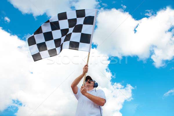 Man waving a checkered flag on a raceway Stock photo © Amaviael