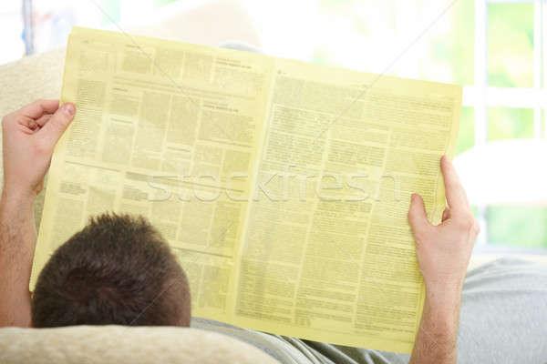 Adam okuma gazete kanepe ev Stok fotoğraf © Amaviael