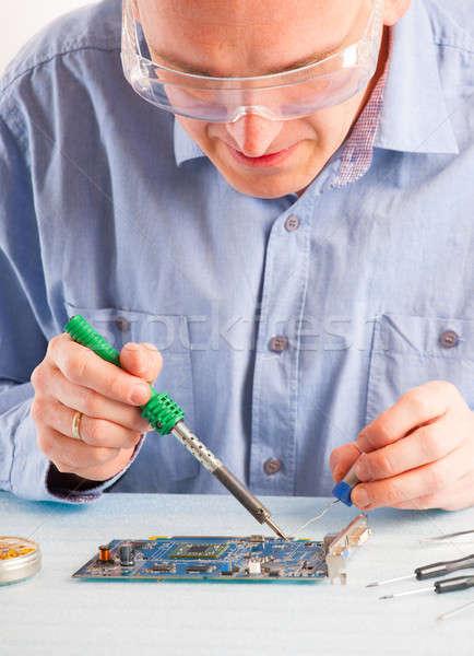 пайка человека инструментом компьютер рабочих Сток-фото © Amaviael