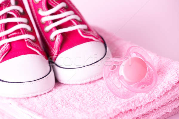 Stock photo: Dummy and baby shoes