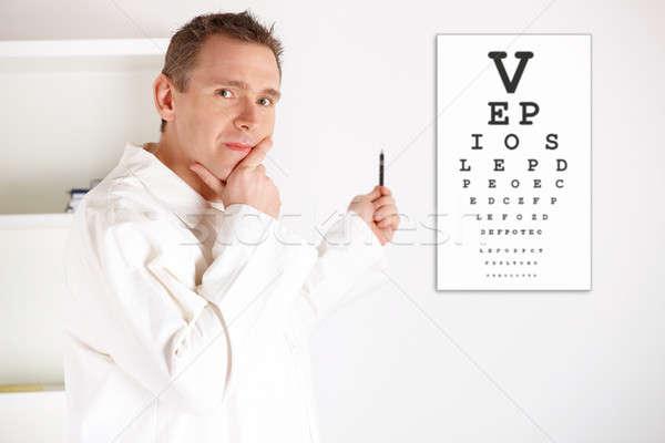 Szemorvos orvos megvizsgál beteg komoly férfi Stock fotó © Amaviael