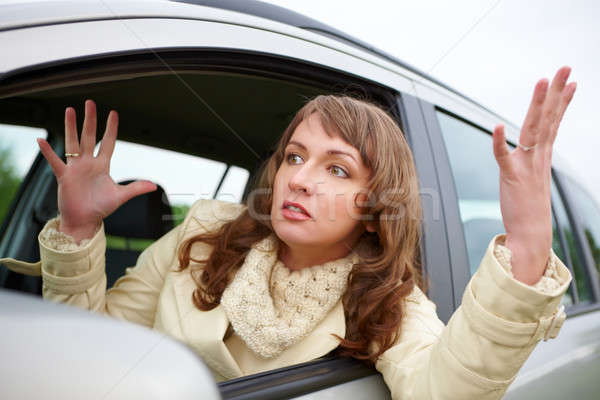 Angry young woman sitting in a car  Stock photo © Amaviael
