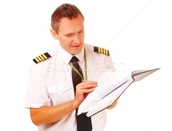 Airline pilot filling in papers Stock photo © Amaviael