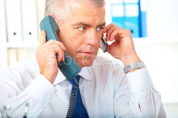 бизнесмен два телефонов зрелый занят рабочих Сток-фото © Amaviael