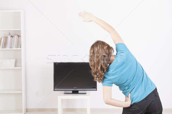 Donna home fitness schermo tv istruzione Foto d'archivio © Amaviael
