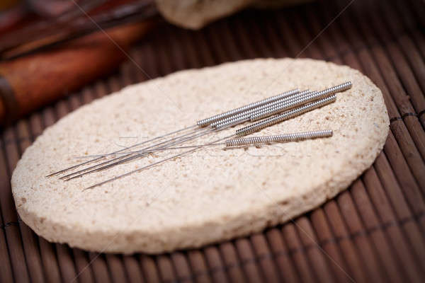 Acupuncture needles on the stone mat Stock photo © Amaviael