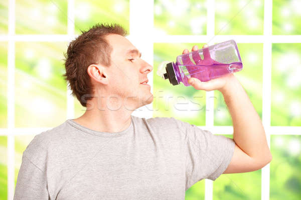 Man holding a water bottle Stock photo © Amaviael