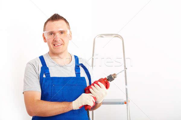 Man with drill Stock photo © Amaviael