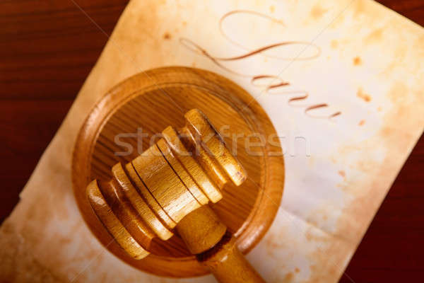 Judges gavel with very old paper Stock photo © Amaviael
